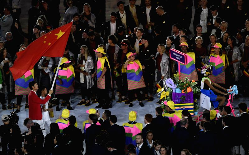 RIO DE JANEIRO, Aug. 5, 2016 - Chinese athlete Lei Sheng leading the Chinese Olympic Delegation enters Maracana Stadium during the opening ceremony of the 2016 Rio Olympic Games in Rio de Janeiro, ...