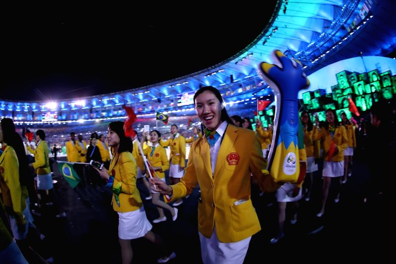 RIO DE JANEIRO, Aug. 5, 2016 - Members of Chinese Olympic delegation parade into Maracana Stadium during the opening ceremony of the 2016 Rio Olympic Games in Rio de Janeiro, Brazil, Aug. 5, 2016. ...