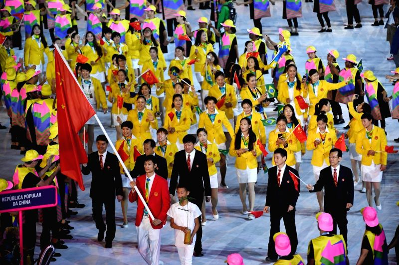 RIO DE JANEIRO, Aug. 5, 2016 - The Chinese Olympic Delegation parade into Maracana Stadium during the opening ceremony of the 2016 Rio Olympic Games in Rio de Janeiro, Brazil, Aug. 5, 2016.