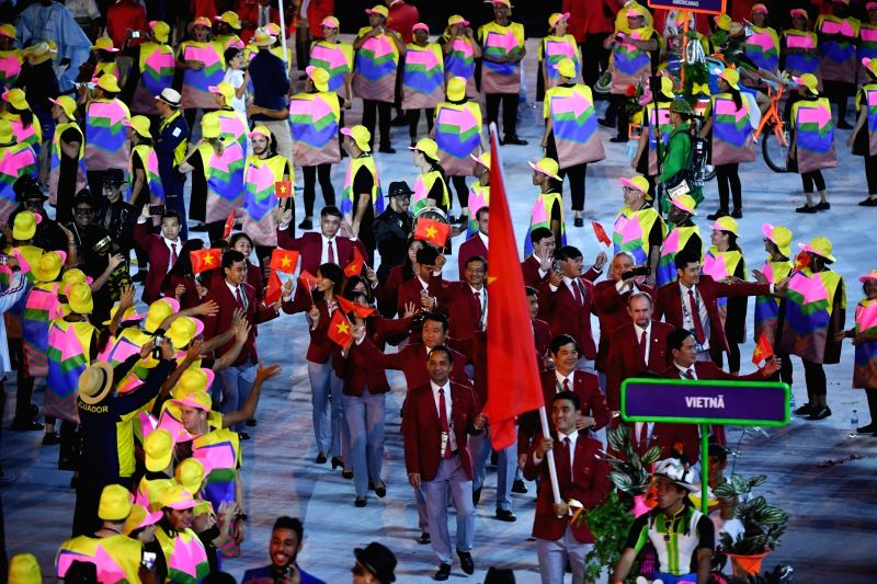 RIO DE JANEIRO, Aug. 5, 2016 - The delegation of Vietnam parade into Maracana Stadium during the opening ceremony of the 2016 Rio Olympic Games in Rio de Janeiro, Brazil, Aug. 5, 2016.