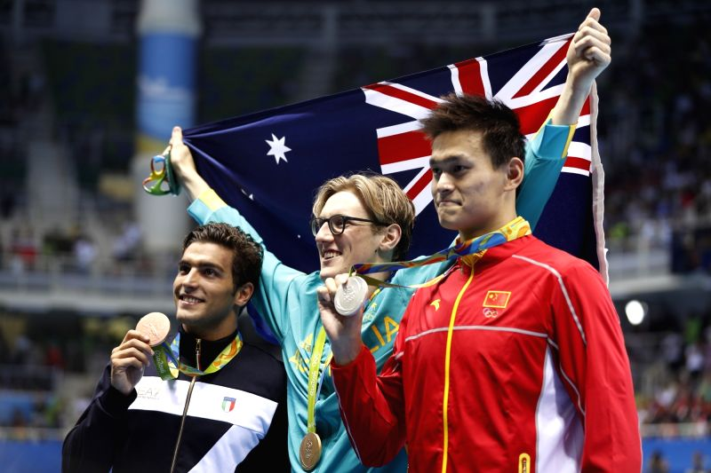 RIO DE JANEIRO, Aug. 6, 2016 - Gold medalist Australia's Mack Horton (C), silver medalist China's Sun Yang (R) and bronze medalist Italy's Gabriele Detti pose for photos after the awarding ceremony ...