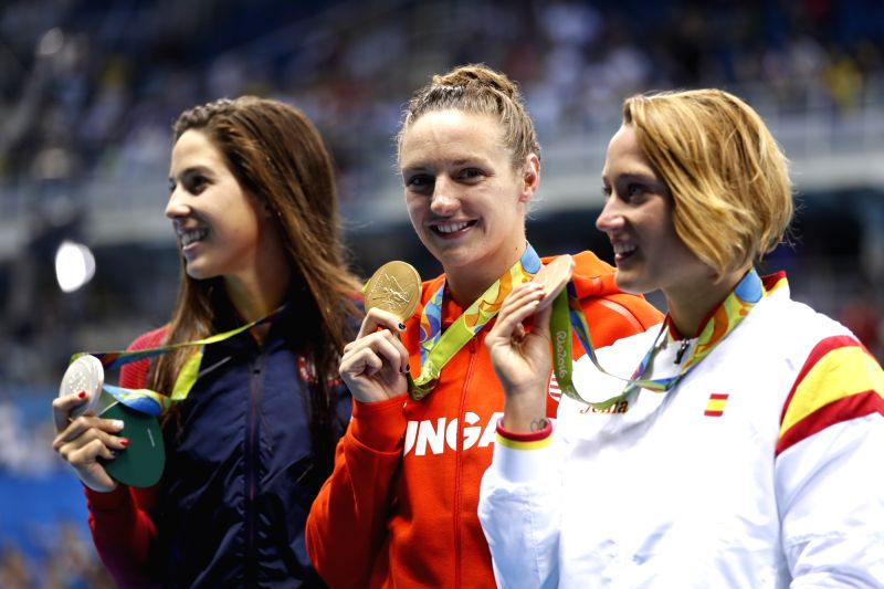 RIO DE JANEIRO, Aug. 6, 2016 - Gold medalist Hungary's Katinka Hosszu (C), silver medalist Maya Dirado from the United States of America and bronze medalist Spain's Mireia Belmonte attend the ...