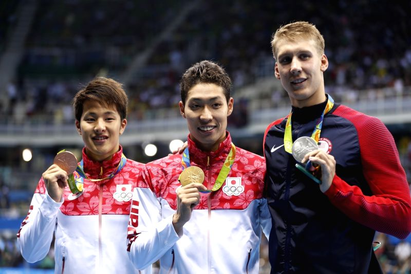 RIO DE JANEIRO, Aug. 6, 2016 - Gold medalist Japan's Kosuke Hagino (C), silver medalist Chase Kalisz (R) of the United States of America and bronze medalist Japan's Daiya Seto attend the awarding ...