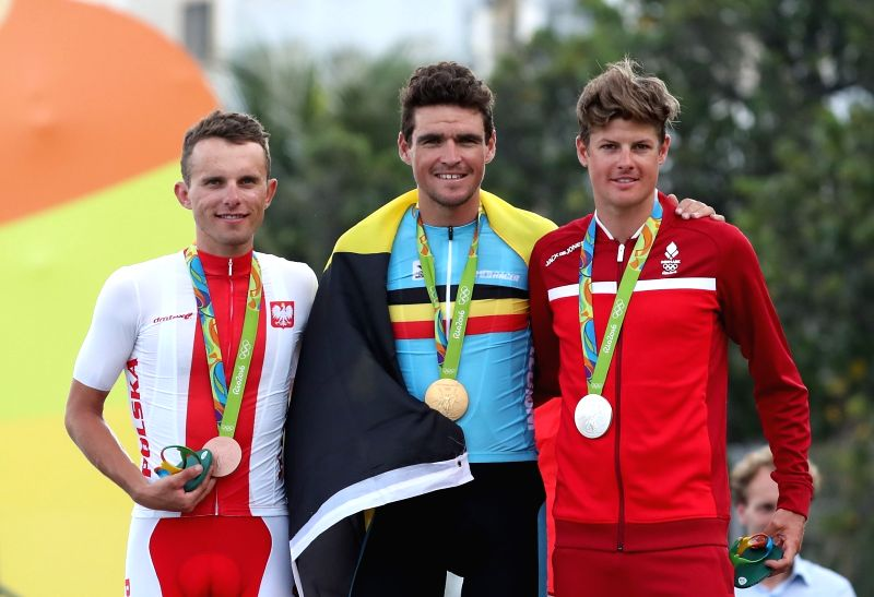 RIO DE JANEIRO, Aug. 6, 2016 - Greg Van Avermaet of Belgium(C), Rafal Majka (L) of Poland and Jakob Fuglsang of Denmark attend the awarding ceremony after the Men's Road cycling race of the Rio 2016 ...
