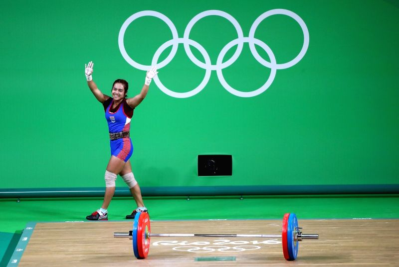 RIO DE JANEIRO, Aug. 6, 2016 - Sopita Tanasan of Thailand waves to the audience during the match of women's 48kg category of weightlifting at the 2016 Rio Olympic Games in Rio de Janeiro, Brazil, on ...