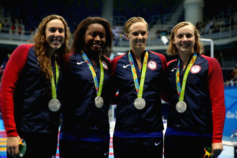 RIO DE JANEIRO, Aug. 6, 2016 - Swimmers from the United States of America attend the awarding ceremony for women's 4x100m freestyle relay final of swimming at the 2016 Rio Olympic Games in Rio de ...