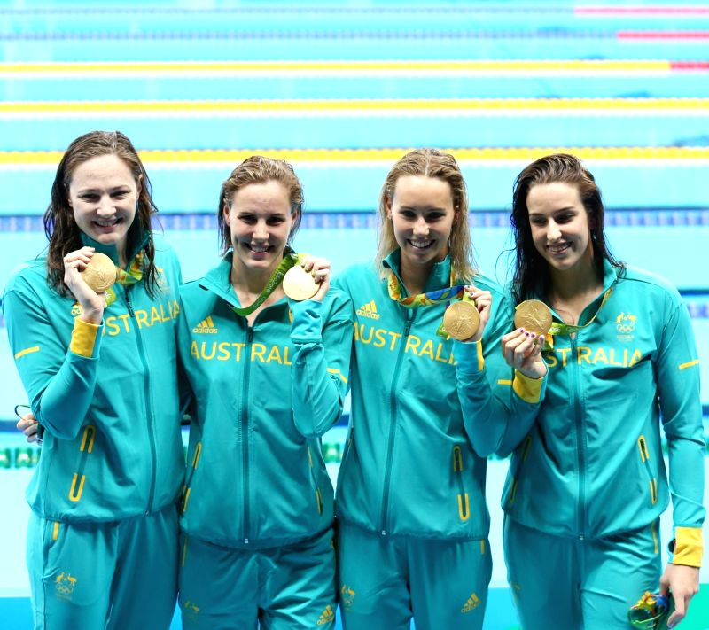RIO DE JANEIRO, Aug. 6, 2016 - Swimmers of Australia show their medals during the awarding ceremony for women's 4x100m freestyle relay final of swimming at the 2016 Rio Olympic Games in Rio de ...