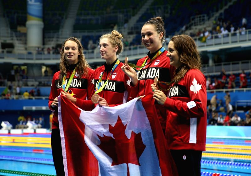 RIO DE JANEIRO, Aug. 6, 2016 - Swimmers of Canada show their medals during the awarding ceremony for women's 4x100m freestyle relay final of swimming at the 2016 Rio Olympic Games in Rio de Janeiro, ...