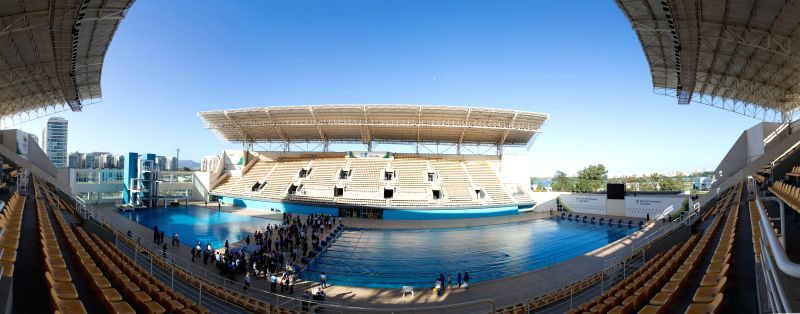 Combo photo taken on Aug. 6, 2014 shows the pool and tribune of the Maria Lenk Aquatic Park in Rio de Janeiro, Brazil, Aug. 6, 2014. Diving and synchronized ..