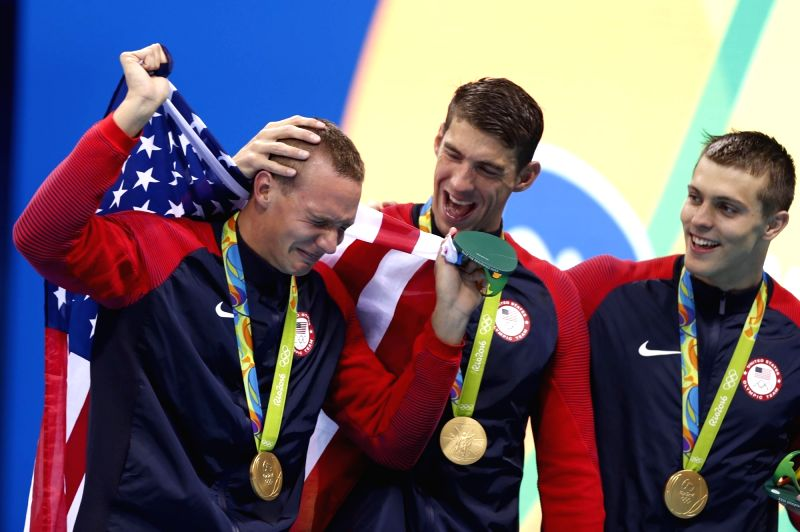 RIO DE JANEIRO, Aug. 7, 2016 - Caeleb Dressel (1st, L) from the United States of America and his teammate celebrate during the awarding ceremony of swimming final of men's 4x100m freestyle relay at ...