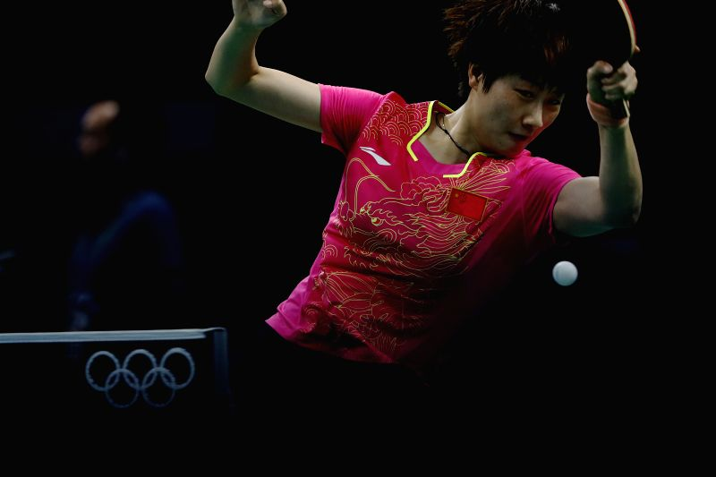 RIO DE JANEIRO, Aug. 7, 2016 - Ding Ning of China returns the ball against Elizabeta Samara of Romania during a 3rd round match of women's singles table tennis at the 2016 Rio Olympic Games in Rio de ...