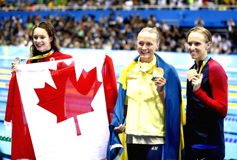 RIO DE JANEIRO, Aug. 7, 2016 - Gold medalist Sweden's Sarah Sjostrom (C), silver medalist Canada's Penny Oleksiak (L) and bronze medalist Dana Vollmer from the United States of America attend the ...