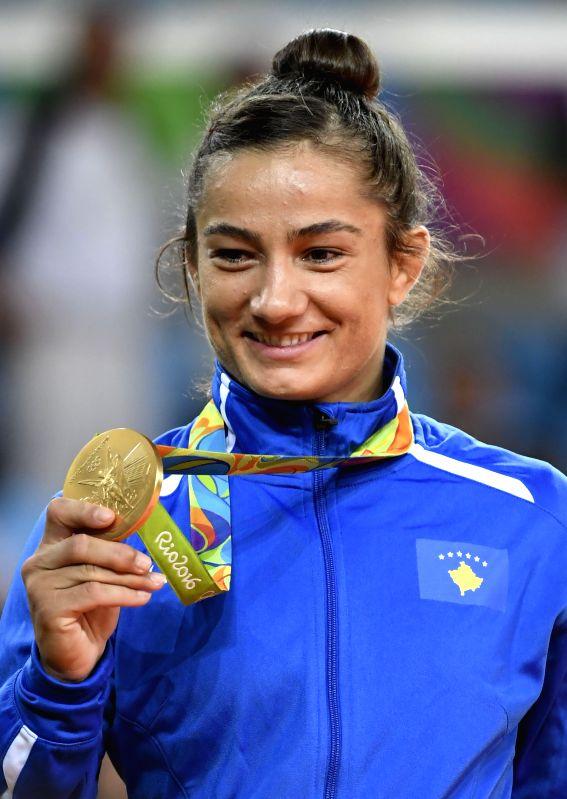 RIO DE JANEIRO, Aug. 7, 2016 - Gold medallist Kosovo's Majlinda Kelmendi shows her medal during the awarding ceremony of women's -52kg judo final at the Rio 2016 Olympic Games in Rio de Janeiro on ...