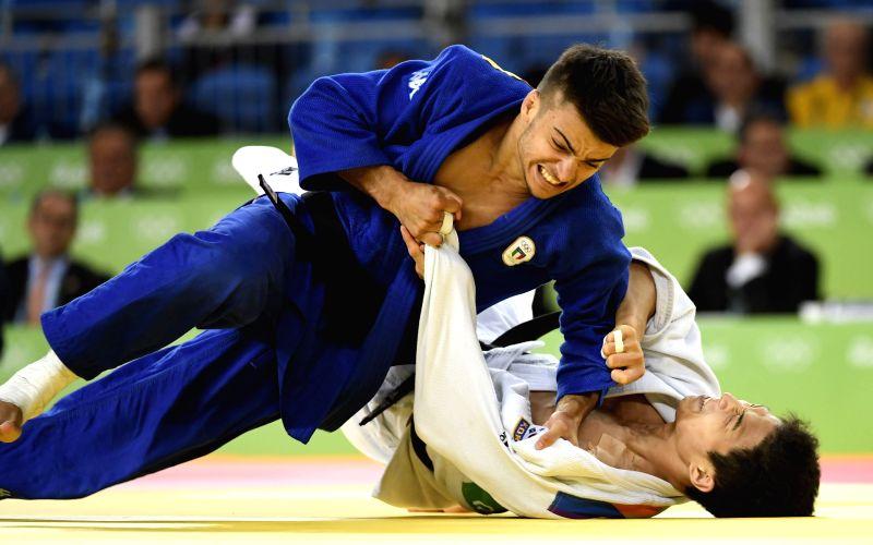 RIO DE JANEIRO, Aug. 7, 2016 - Italy's Fabio Basile (top) competes with South Korea's An Baul during the men's -66kg judo final at the Rio 2016 Olympic Games in Rio de Janeiro on Aug. 7, 2016. Fabio ...