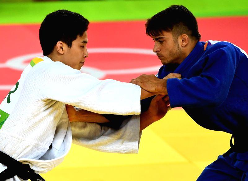 RIO DE JANEIRO, Aug. 7, 2016 - Italy's Fabio Basile (R) competes with South Korea's An Baul during the men's -66kg judo final at the Rio 2016 Olympic Games in Rio de Janeiro on Aug. 7, 2016. Fabio ...