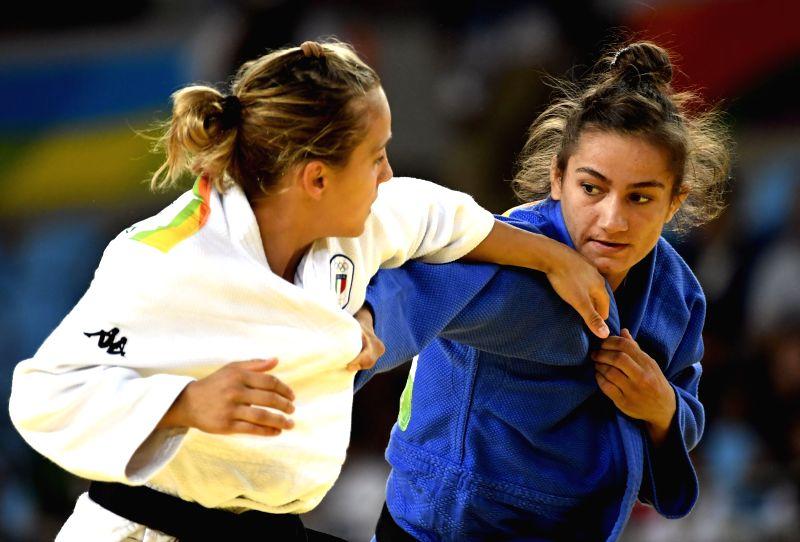 RIO DE JANEIRO, Aug. 7, 2016 - Kosovo's Majlinda Kelmendi (R) competes with Italy's Odette Giuffrida during the women's -52kg judo final at the Rio 2016 Olympic Games in Rio de Janeiro on Aug. 7, ...