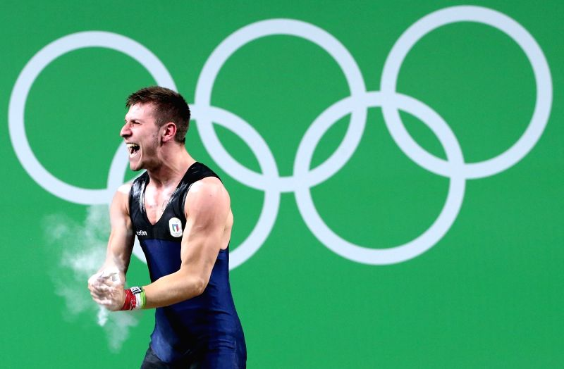 RIO DE JANEIRO, Aug. 7, 2016 - Mirco Scarantino of Italy reacts during the men's 56kg final of weightlifting at the 2016 Olympic Games, in Rio de Janeiro, Brazil, on Aug. 7, 2016. Mirco Scarantino ...