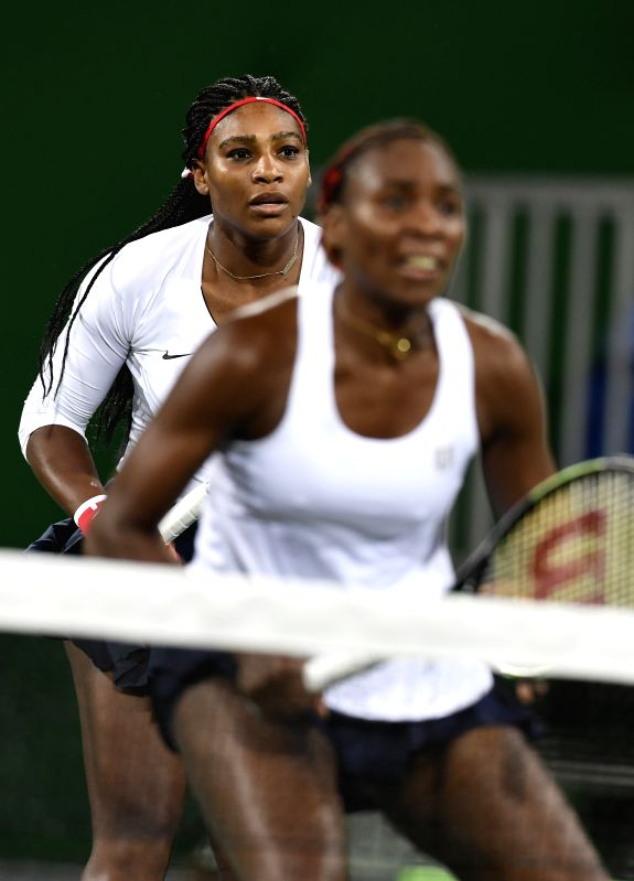 RIO DE JANEIRO, Aug. 7, 2016 - Venus Williams (R) and Serena Williams compete during women's first round doubles tennis match against Czech Republic's Lucie Safarova/Barbora Strycova at the 2016 Rio ...
