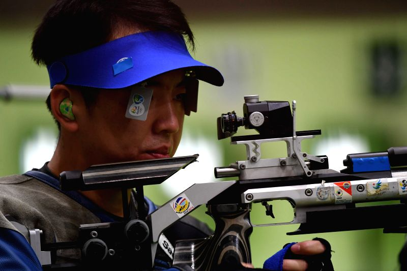 RIO DE JANEIRO, Aug. 8, 2016 - Cao Yifei of China reacts during the men's 10m Air Rifle Qualification of Shooting in Rio de Janeiro, Brazil, on Aug. 8, 2016. Cao Yifei ranked 9th in Qualification ...
