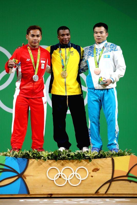 RIO DE JANEIRO, Aug. 8, 2016 - Gold medalist Oscar Albeiro Figueroa Mosquera of Colombia (C), silver medalist Eko Yuli Irawan (L) of Indonesia, and bronze medalist Farkhad Kharki of Kazakhstan show ...