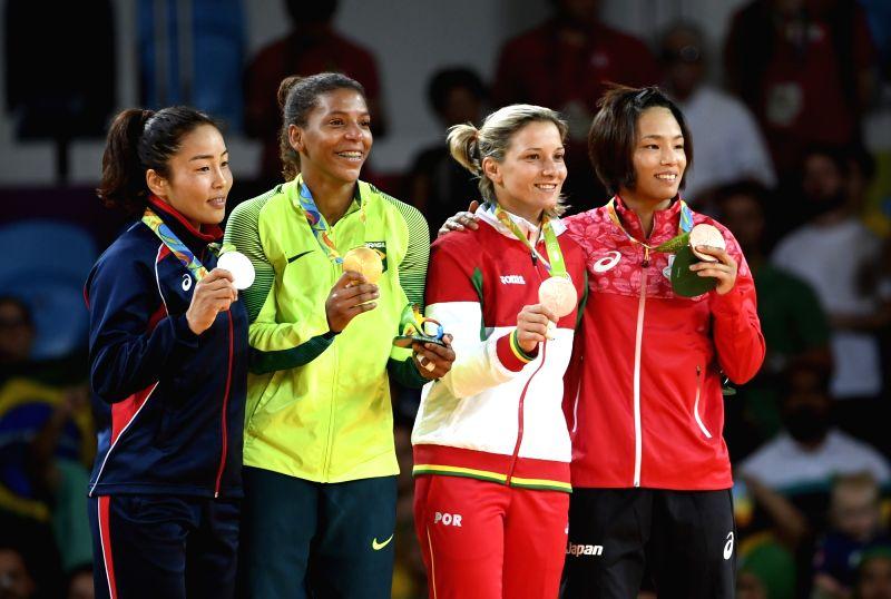 RIO DE JANEIRO, Aug. 8, 2016 - Gold medalist Rafaela Silva (2nd, L) of Brazil, silver medalist Sumiya Dorjsuren of Mongolia (1st, L), bronze medalists Telma Monteiro of Portugal (2nd, R) and Kaori ...