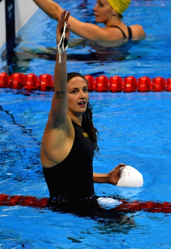 RIO DE JANEIRO, Aug. 8, 2016 - Hungary's Katinka Hosszu (front) celebrates after the women's 100m backstroke swimming final at the 2016 Rio Olympic Games in Rio de Janeiro, Brazil, on Aug. 8, 2016. ...