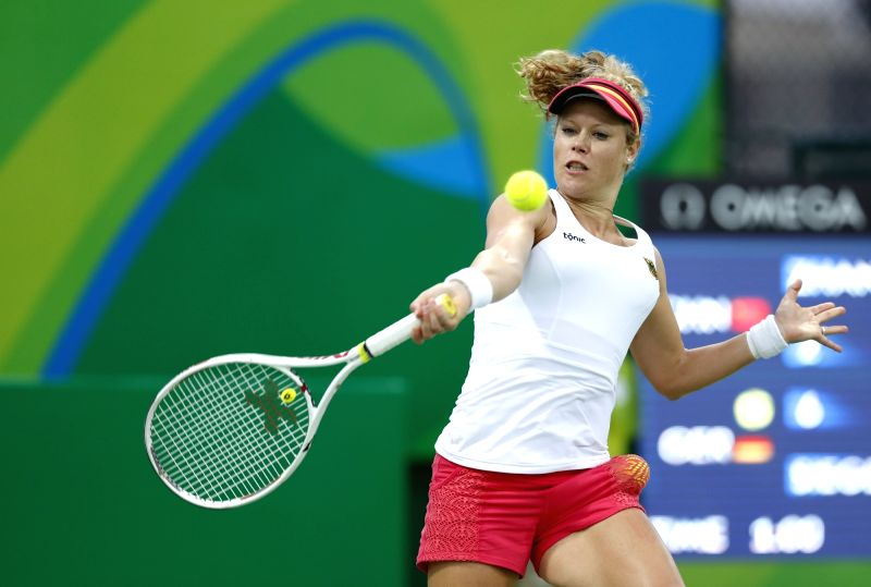 RIO DE JANEIRO, Aug. 8, 2016 - Laura Siegemund of Germany returns the ball against Zhang Shuai of China during a second round match of women's singles tennis at the 2016 Rio Olympic Games in Rio de ...