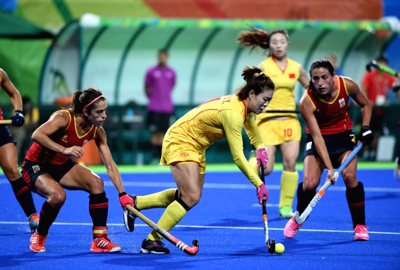 RIO DE JANEIRO, Aug. 8, 2016 - Liang Meiyu (C) of China competes during a women's group match of hockey between China and Spain at the 2016 Rio Olympic Games in Rio de Janeiro, Brazil, on Aug. 8, ...