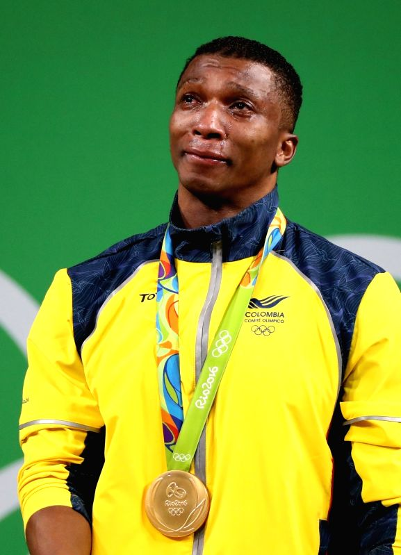 RIO DE JANEIRO, Aug. 8, 2016 - Oscar Albeiro Figueroa Mosquera of Colombia reacts during the awarding ceremony of men's 62kg weightlifting competition at the 2016 Olympic Games, in Rio de Janeiro, ...