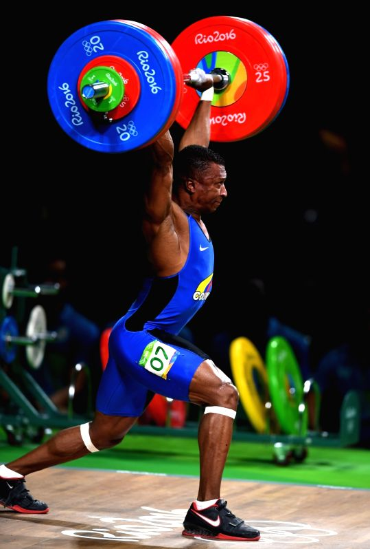 RIO DE JANEIRO, Aug. 8, 2016 - Oscar Albeiro Figueroa Mosquera of Colombia competes during the men's 62kg weightlifting competition at the 2016 Olympic Games, in Rio de Janeiro, Brazil, on Aug. 8, ...