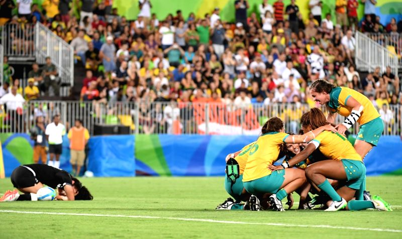 RIO DE JANEIRO, Aug. 8, 2016 - Players of Australia celebrate during the gold medal match of women's rugby sevens between Australia and New Zealand at the 2016 Rio Olympic Games in Rio de Janeiro, ...