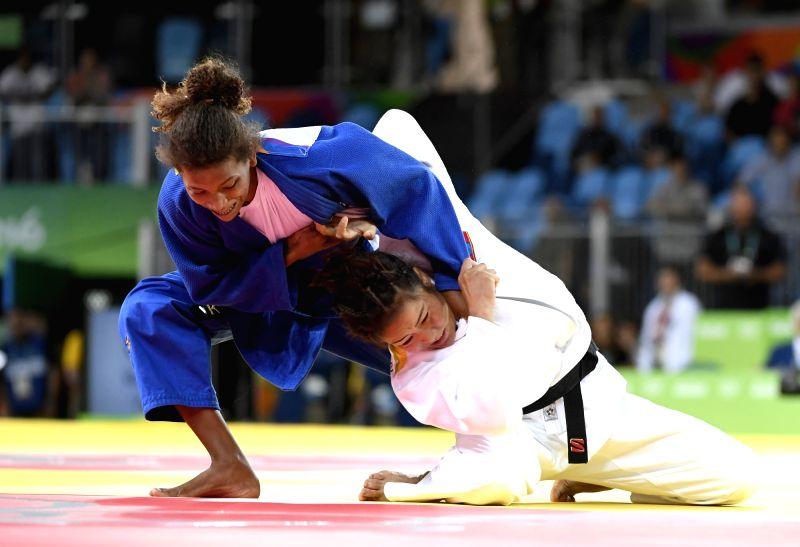 RIO DE JANEIRO, Aug. 8, 2016 - Rafaela Silva (L) of Brazil competes against Sumiya Dorjsuren of Mongolia during the women's -57kg judo final at the 2016 Rio Olympic Games in Rio de Janeiro, Brazil, ...
