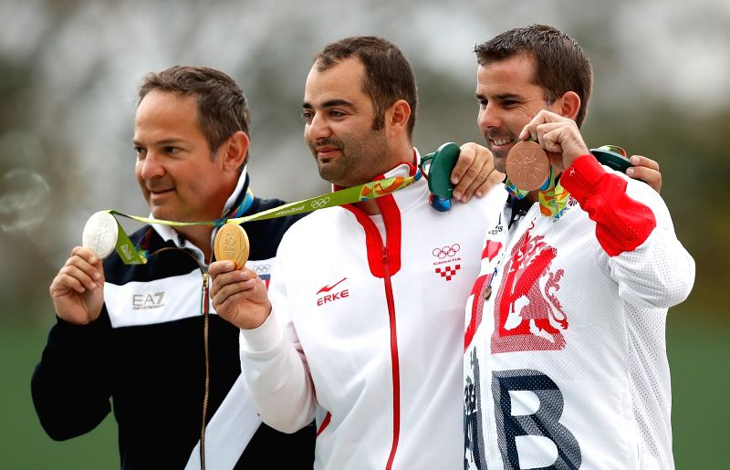 RIO DE JANEIRO, Aug. 8, 2016 - Silver medallist Italy's Giovanni Pellielo (L), gold medallist Croatia's Josip Glasnovic (C) and bronze medallist Britain's Edward Ling pose on the podium during the ...