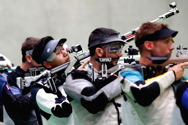 RIO DE JANEIRO, Aug. 8, 2016 - Yang Haoran (2nd L) of China competes during the men's 10m Air Rifle Qualification of Shooting in Rio de Janeiro, Brazil, on Aug. 8, 2016.  Yang Haoran ranked 31st in ...