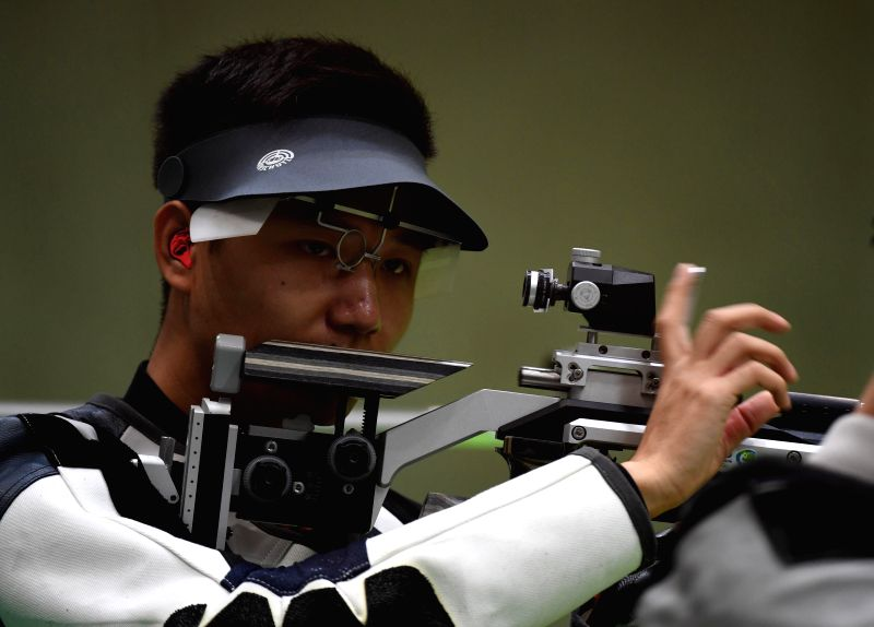 RIO DE JANEIRO, Aug. 8, 2016 - Yang Haoran of China reacts during the men's 10m Air Rifle Qualification of Shooting in Rio de Janeiro, Brazil, on Aug. 8, 2016. Yang Haoran ranked 31st in ...