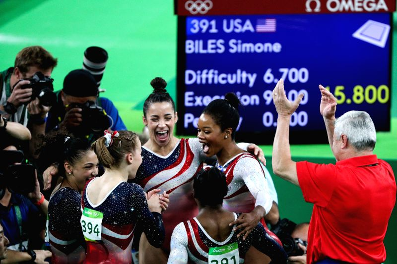 RIO DE JANEIRO, Aug. 9, 2016 - Athletes of the United States of America celebrate after the women's team final of Artistic Gymnasitcs at the 2016 Rio Olympic Games in Rio de Janeiro, Brazil, on Aug. ...