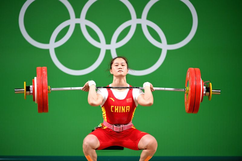 RIO DE JANEIRO, Aug. 9, 2016 - Deng Wei of China competes during the women's 63KG weightlifting group A final at the 2016 Rio Olympic Games in Rio de Janeiro, Brazil, on Aug. 9, 2016. Deng Wei won ...