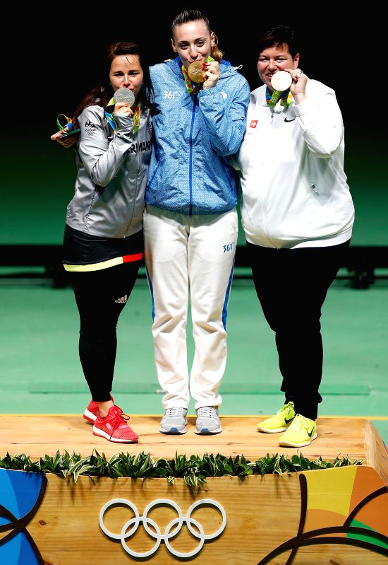 RIO DE JANEIRO, Aug. 9, 2016 - Gold medalist Anna Korakaki (C) of Greece, silver medalist Monika Karsch (L) of Germany and bronze medalist Heidi Diethelm Gerber of Switzerland show their medals ...