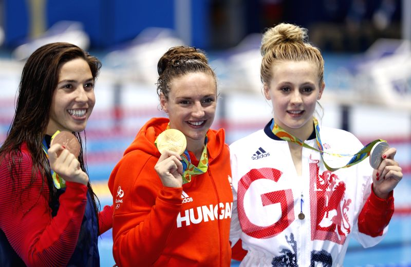 RIO DE JANEIRO, Aug. 9, 2016 - Gold medalist Hungary's Katinka Hosszu (C), silver medalist Britain's Siobhan-Marie O'Connor (R), bronze medalist Maya Dirado of the United States of America attend the ...