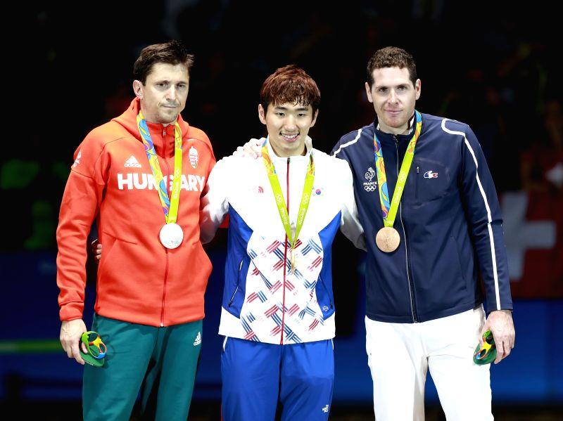 RIO DE JANEIRO, Aug. 9, 2016 - Gold medalist South Korea's Park Sangyoung (C), silver medalist Hungary's Geza Imre (L) and bronze medalist France's Gautheir Grumier attend the awarding ceremony of ...