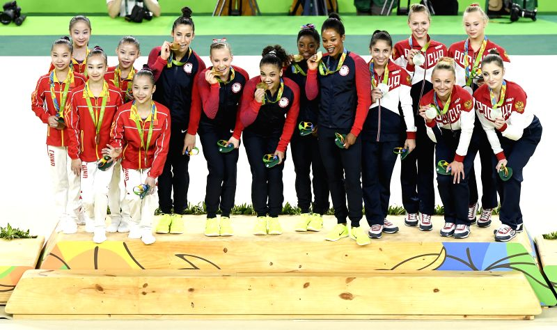 RIO DE JANEIRO, Aug. 9, 2016 - Gold medalists athletes of the United States of America (C), silver medalists athletes of Russia (R) and bronze medalists athletes of China attend the awarding ceremony ...