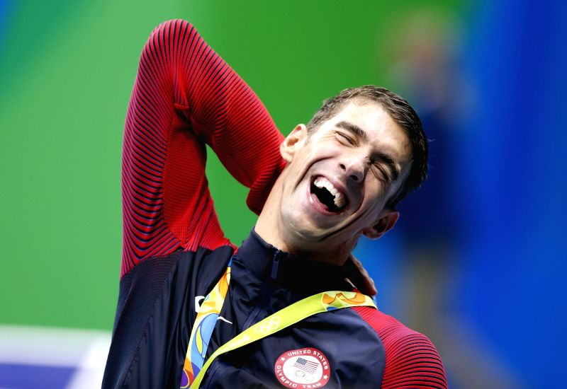 RIO DE JANEIRO, Aug. 9, 2016 - Michael Phelps of the United States of America reacts during the awarding ceremony for the men?s 200m butterfly final of swimming at the 2016 Rio Olympic Games in Rio ...