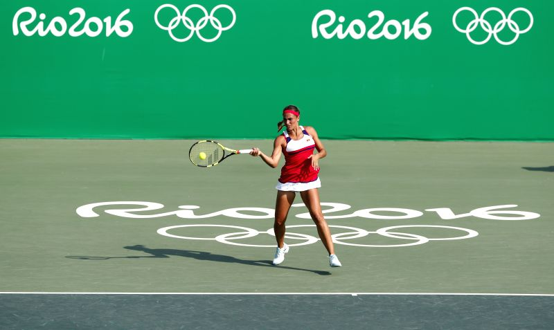 RIO DE JANEIRO, Aug. 9, 2016 - Puerto Rico's Monica Puig competes during a women's singles third round match of tennis against Spain's Garbine Muguruza at the 2016 Rio Olympic Games in Rio de ...
