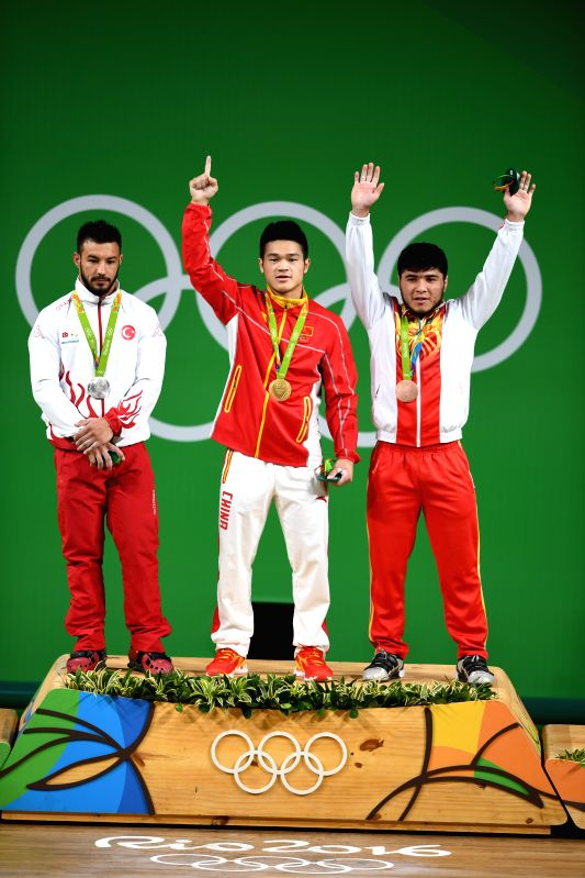 RIO DE JANEIRO, Aug. 9, 2016 - Shi Zhiyong of China (C), Daniyar Ismayilov of Turkey (L) and Izzat Artykov of Kyrgyzstan celebrate at the awarding ceremony of the men's 69KG weightlifting group A ...