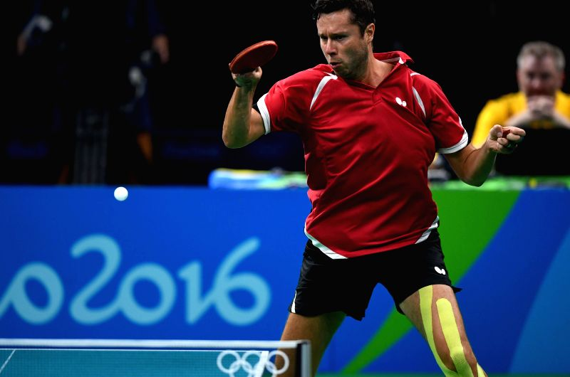 RIO DE JANEIRO, Aug. 9, 2016 - Vladimir Samsonov of Belarus competes during a men's singles quarterfinal match of table tennis against Dimitrij Ovtcharov of Germany at the 2016 Rio Olympic Games in ...