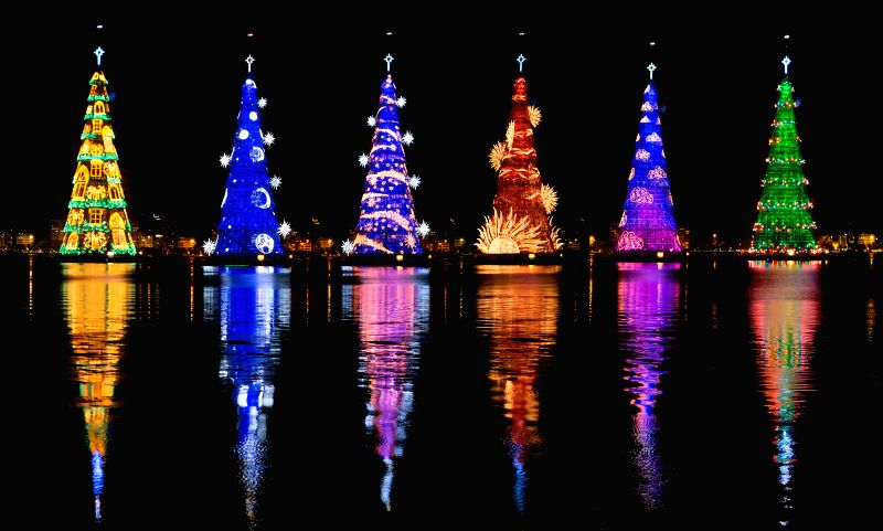 Rio de Janeiro: Combo photo taken on Dec. 15, 2014 shows a giant Christmas tree on the lake of Rodrigo de Freitas in Rio de Janeiro, Brazil, on Dec. 15, 2014. The giant tree, which is 85 meters tall .