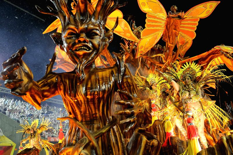 "Performers from the ""Viradouro"" samba school participate in the carnival samba parade at the Sambadrome in Rio de Janeiro, Brazil, Feb. 15, 2015. .."
