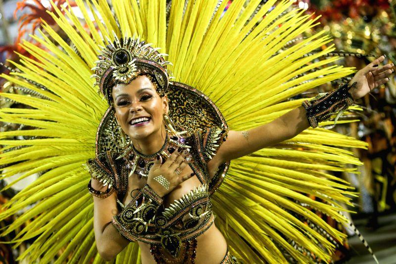 "A reveller from ""Sao Clemente"" samba school participates in the carnival samba parade at the Sambadrome in Rio de Janiero, Brazil, Feb. 16, 2015. .."