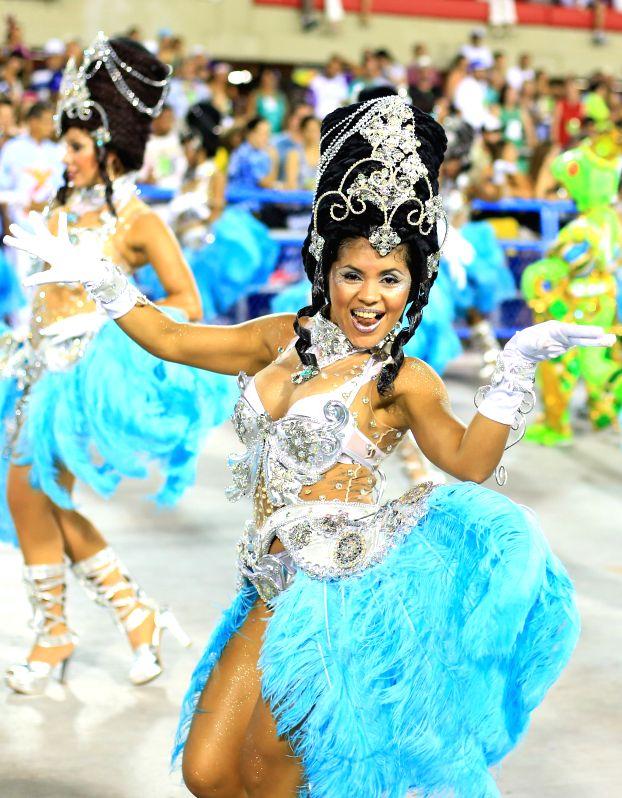 Revellers participate in the carnival samba parade at the Sambadrome in Rio de Janiero, Brazil, Feb. 17, 2015.