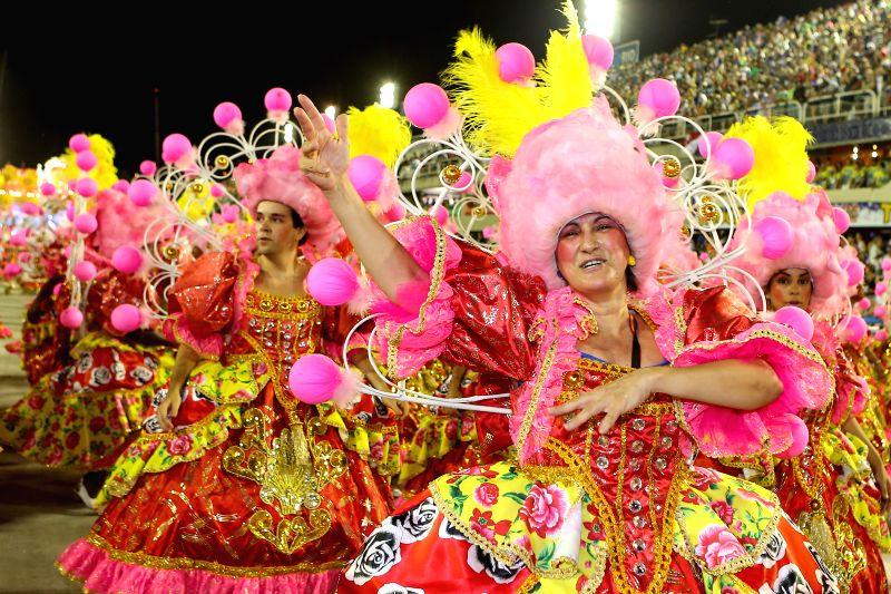 """Revellers from """"Sao Clemente"""" samba school participate in the carnival samba parade at the Sambadrome in Rio de Janiero, Brazil, Feb. 16, 2015. ..."""